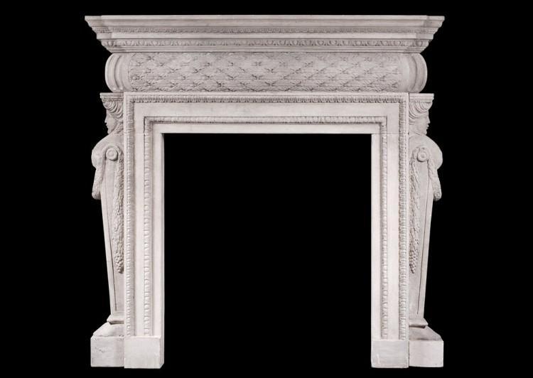 A petite Georgian style stone fireplace