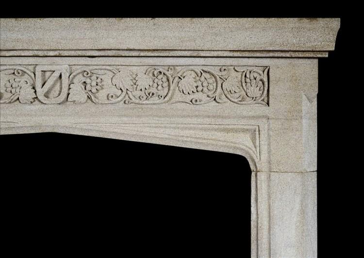AN ENGLISH GOTHIC STONE FIREPLACE WITH CARVED FRIEZE-Detail1
