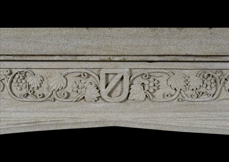 AN ENGLISH GOTHIC STONE FIREPLACE WITH CARVED FRIEZE-Detail2