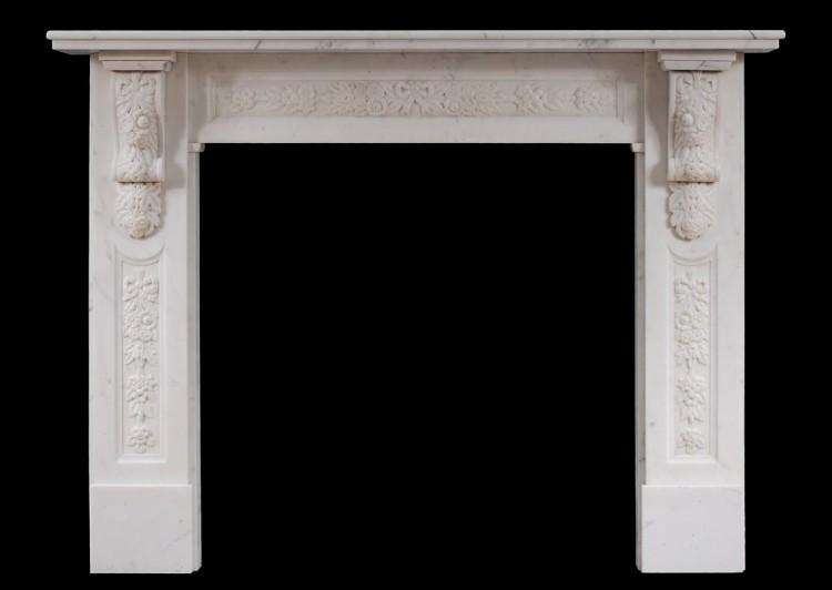 An early Victorian English Statuary marble fireplace