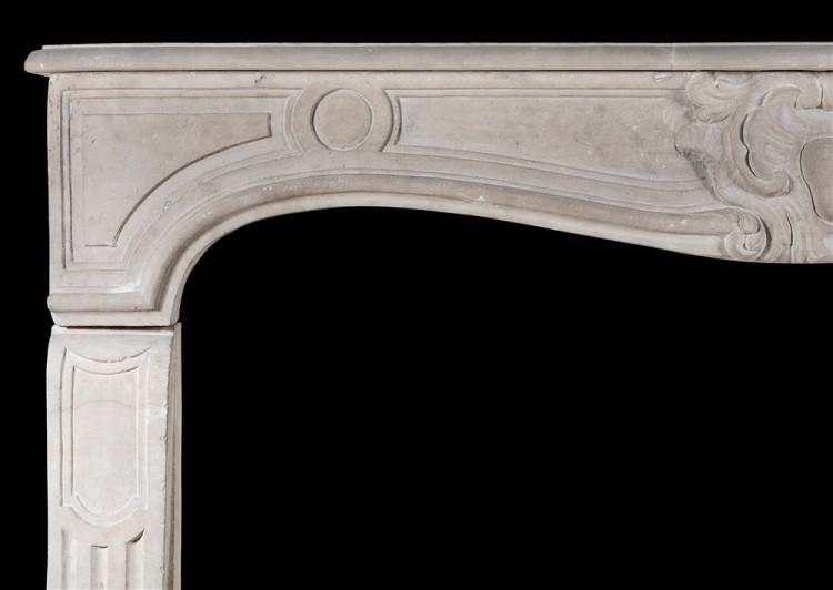 A 19TH CENTURY FRENCH LIMESTONE CHIMNEYPIECE IN THE LOUIS XV STYLE-Detail2