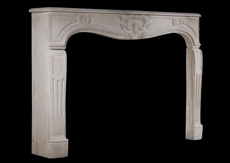 A 19TH CENTURY FRENCH LIMESTONE CHIMNEYPIECE IN THE LOUIS XV STYLE-Detail3