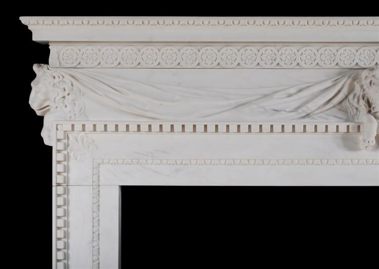 A WHITE MARBLE FIREPLACE WITH CARVED LION'S MASK-Detail2