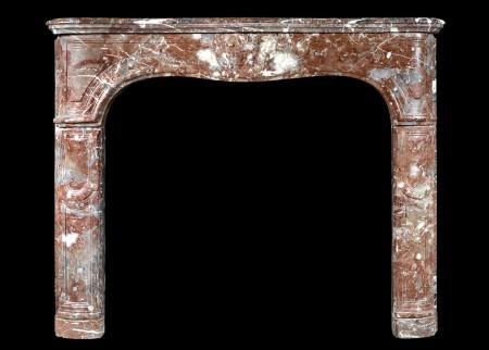 AN 18TH CENTURY FRENCH LOUIS XV FIREPLACE IN LANGUEDOC MARBLE