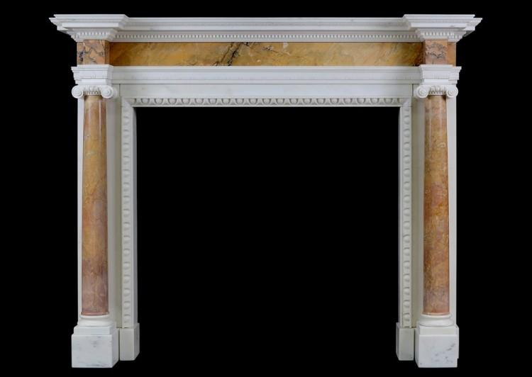 An English Statuary marble fireplace with Siena columns