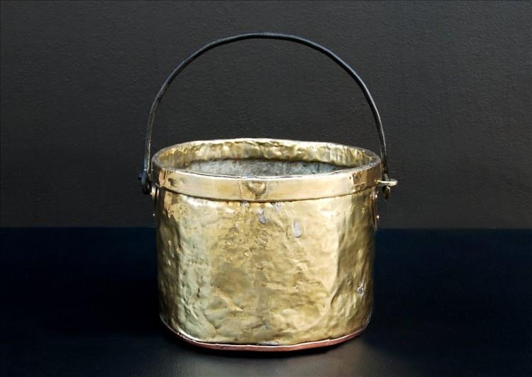 A petite brass coal bucket