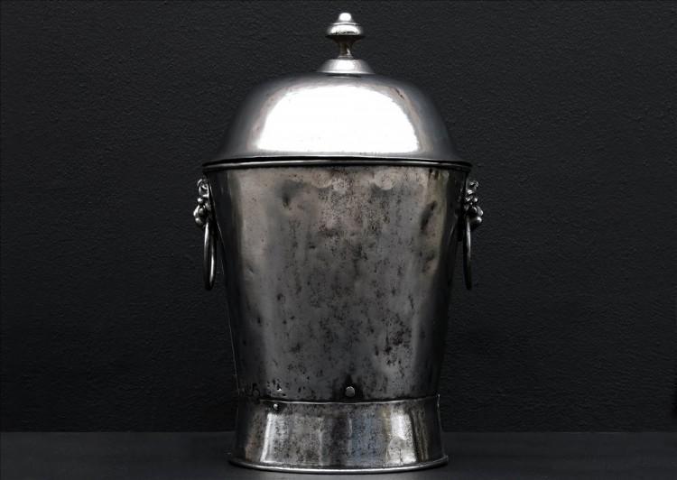 A polished steel coal English bucket