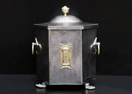 A POLISHED STEEL COAL BUCKET WITH BRASS ENRICHMENTS