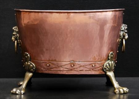 A COPPER COAL BUCKET WITH BRASS LION'S MASKS
