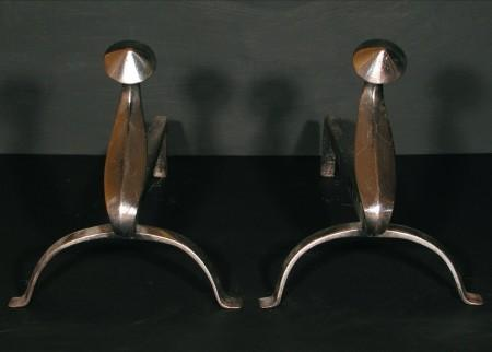A PAIR OF POLISHED STEEL FIREDOGS