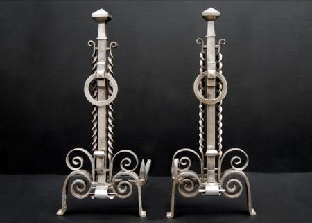 A PAIR OF UNUSUAL 19TH CENTURY ENGLISH STEEL FIREDOGS