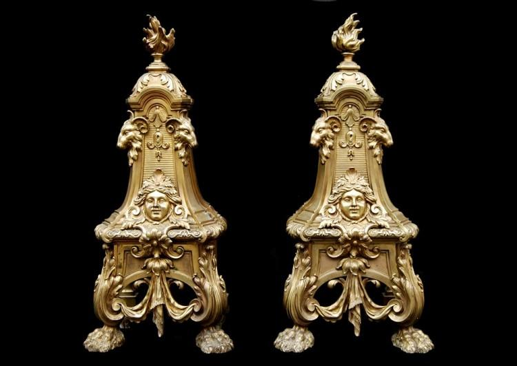 A pair of mid 19th century French brass andirons