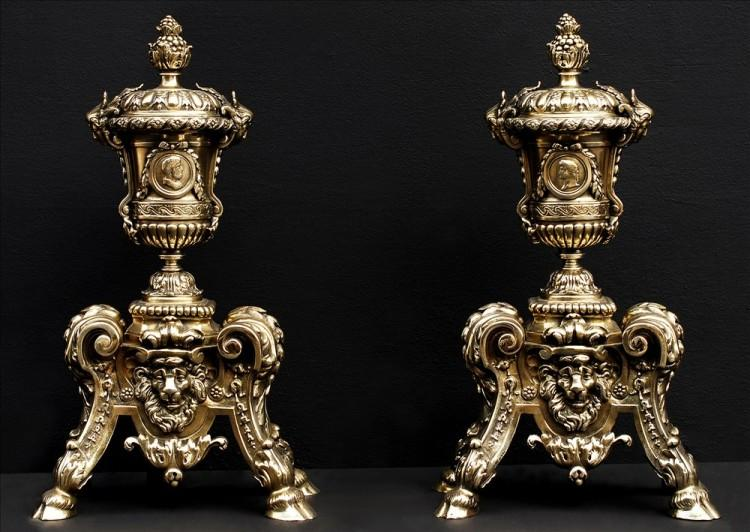 A decorative pair of brass firedogs