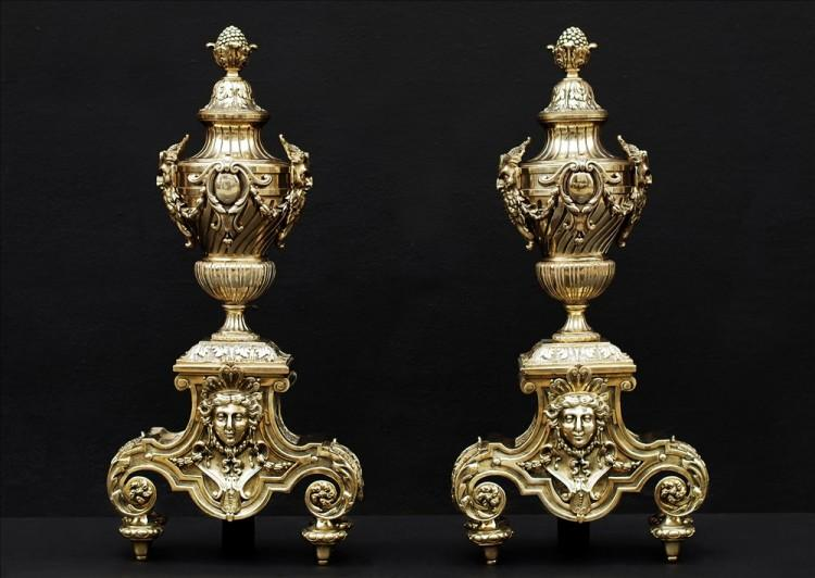A pair of ornate brass chenets