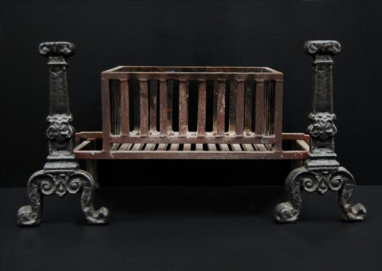 A large cast iron rectangular firebasket with vertical bars