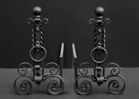 A PAIR OF SCROLLED WROUGHT IRON FIREDOGS