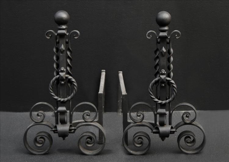A pair of scrolled wrought iron firedogs – 11 inch