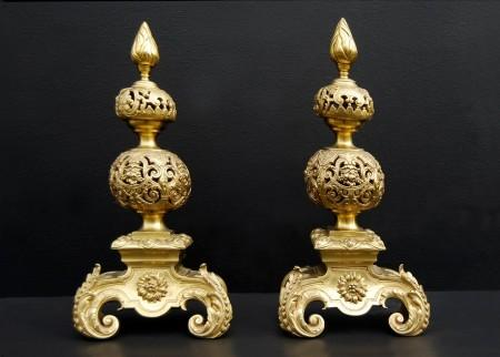 A PAIR OF RICHLY ADORNED BAROQUE STYLE GILT BRONZE ANDIRONS