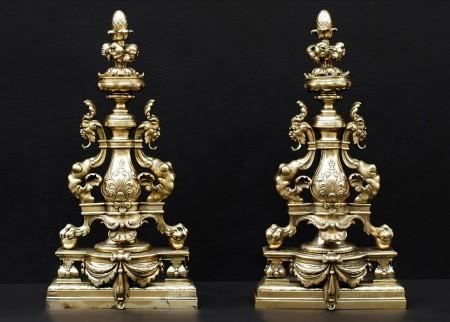 A DECORATIVE PAIR OF ENGLISH BRASS FIREDOGS