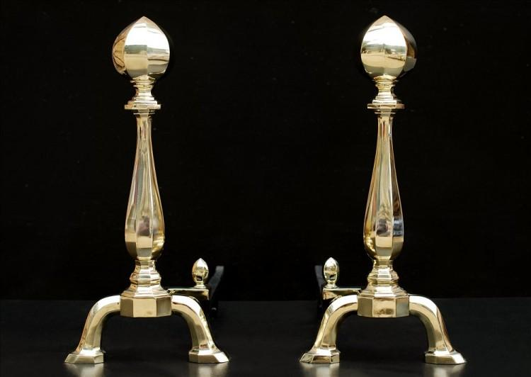 An imposing pair of brass andirons