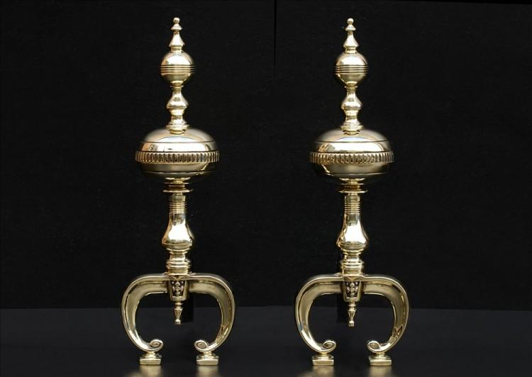 A pair of English brass firedogs