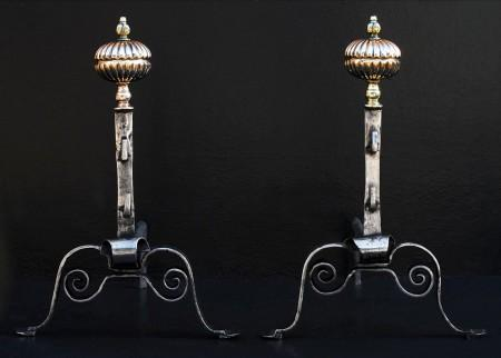 A PAIR OF ENGLISH POLISHED STEEL FIREDOGS WITH BRASS FINIAL