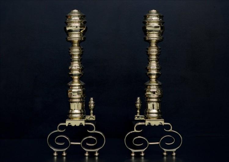 An impressive pair of brass firedogs
