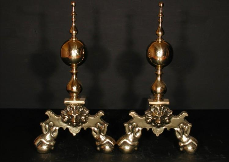 A pair of brass firedogs