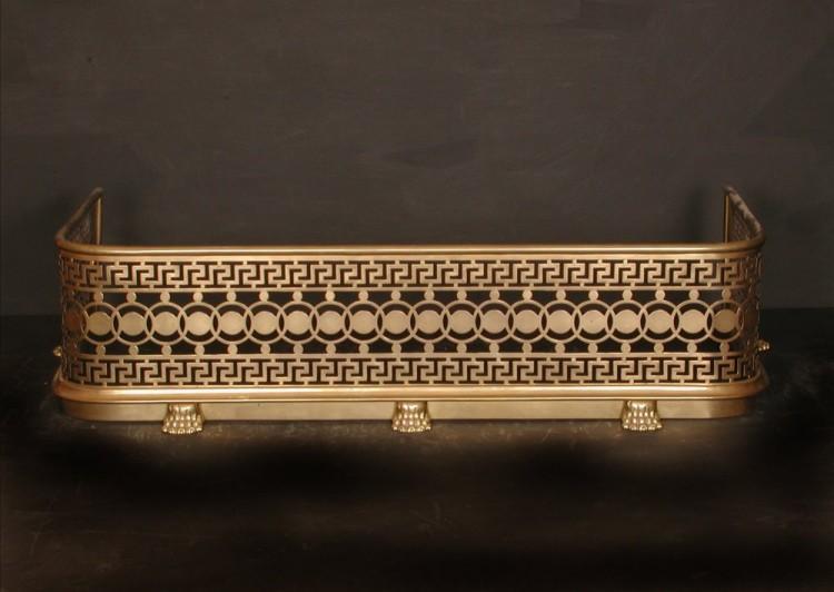 A pierced brass English fender