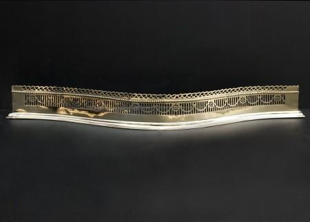 AN ATTRACTIVE BRASS SERPENTINE FENDER