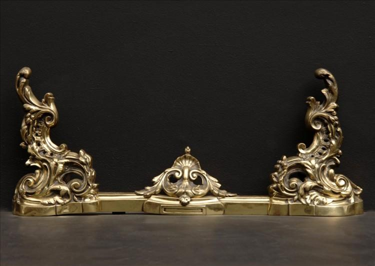 An ornate brass french fender