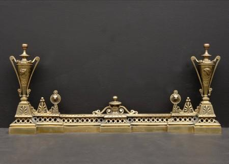 A DECORATIVE BRASS FRENCH FENDER