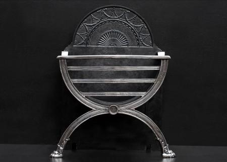 AN ENGLISH POLISHED CAST IRON FIREGRATE