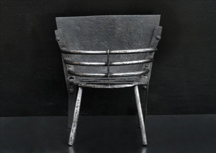 A small polished cast iron firebasket