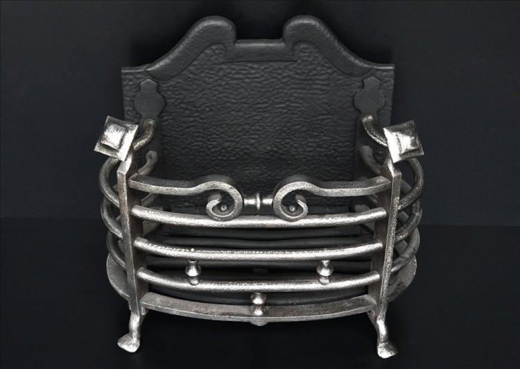 A POLISHED WROUGHT IRON FIREBASKET FROM THE ARTS AND CRAFTS MOVEMENT-Detail1