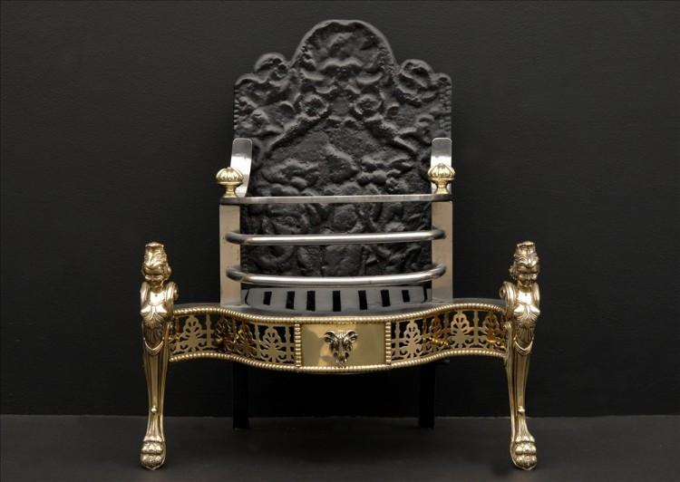 A 19th century Dutch steel and brass fire basket