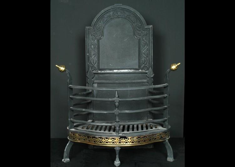 A 19th century cast iron Dutch basket grate