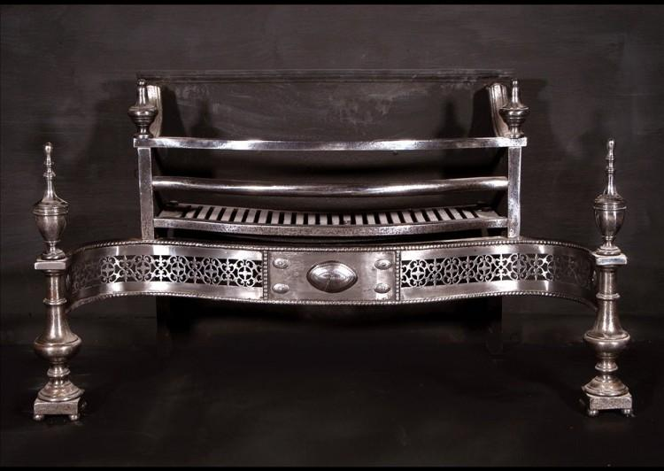 An impressive 19th century English polished steel firegrate