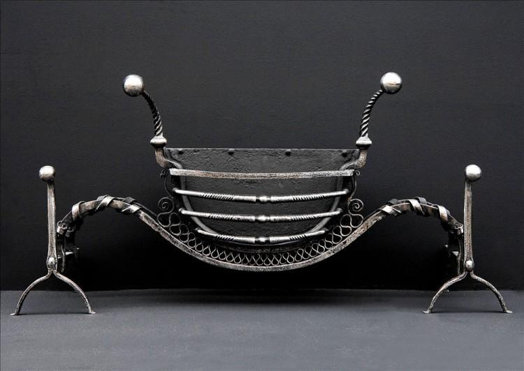 A very unusual late 18th century wrought iron firegrate