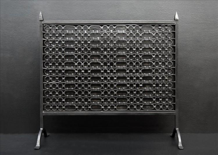 A cast iron firescreen in the Gothic manner