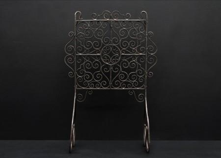 AN ATTRACTIVE ENGLISH WROUGHT IRON FIRESCREEN