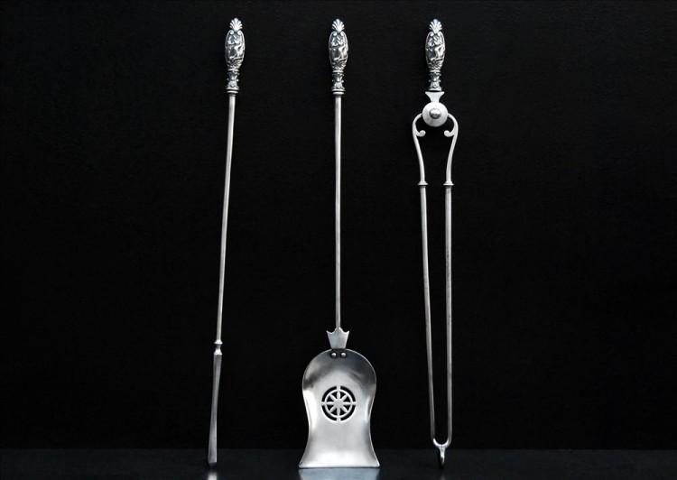 A set of 19th century polished antique steel firetools