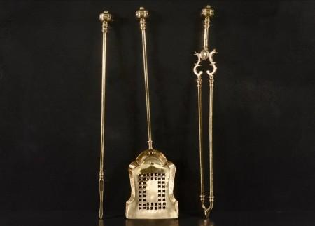 A SET OF LATE 19TH CENTURY BRASS FIRETOOLS
