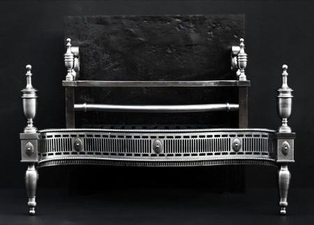 A GEORGE III STYLE STEEL FIREGRATE