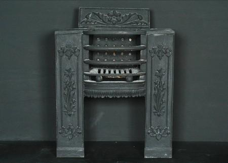 A PETITE 19TH CENTURY CAST IRON BLACK HOB GRATE