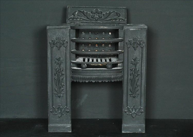 A petite 19th century cast iron black hob grate