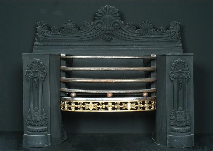 A 19th century English cast iron hob-grate with brass fret