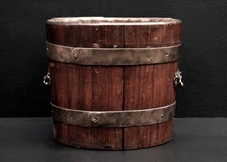 A RUSTIC WOOD COAL BUCKET