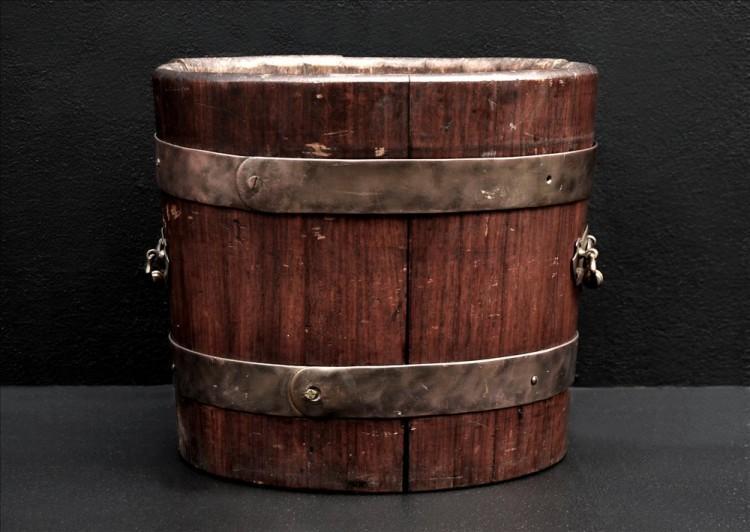 A rustic wood coal bucket