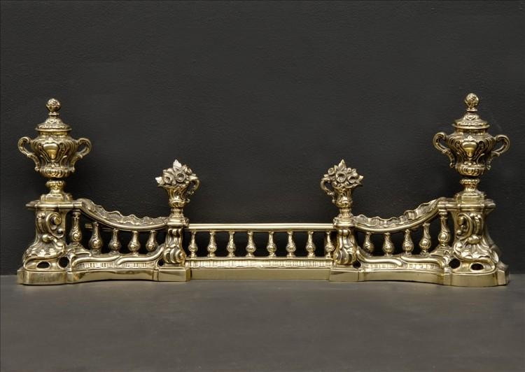 An ornate brass french fender